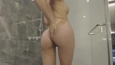 Miss Alice taking a shower